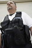Security Guard In Bulletproof Vest. Low angle view of a security guard in bulletproof vest royalty free stock photography