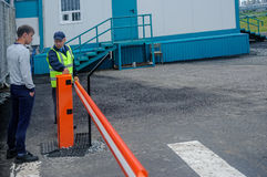Security guard controls access to territory Stock Photos