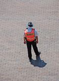 Security guard directing traffic. Public place security guard giving directions royalty free stock images