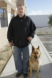 Security Guard With Dog Stock Photo