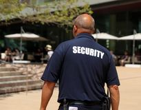 Security Guard On Duty. Walking around Lincoln Center Plaza In NYC royalty free stock image