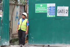 Security guard at the entrance of a construction site Stock Image