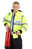 Security guard with a fire extinguisher. A security guard with a fire extringuisher, isolated on white stock photography