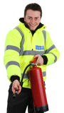 Security guard with a fire extinguisher. A security guard with a fire extinguisher, isolated on white royalty free stock images