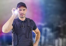 Security guard with flashlight against blurry wall and city sketch royalty free stock photo
