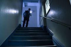 Security Guard With Flashlight. Male Security Guard Searching On Stairway With Flashlight stock photo