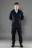 Security guard full body. Isolated on gray background royalty free stock photography