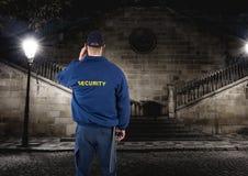 Security guard guarding the park at night. Digital composite of security guard guarding the park at night Royalty Free Stock Photos