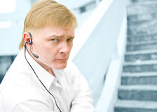 Security guard in head phone. On stairs stock image
