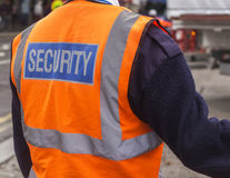 Security. Guard holding people while passing a vehicle Royalty Free Stock Images