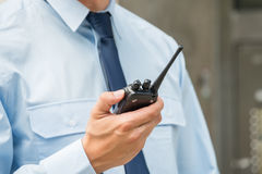 Security Guard Holding Walkie-talkie Royalty Free Stock Image