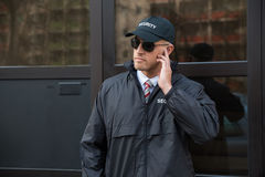 Free Security Guard In Front Of The Door Entrance Stock Photo - 57966210