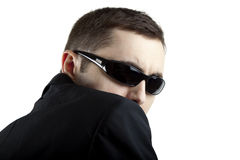 Security guard isolated on white. Young man in security guard pose with suit and shades or sunglasses; isolated on white background stock photos