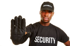 Security guard keeping distance. With his hand stock images