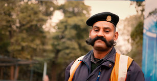Security Guard with long yosemite style mustache. Royalty Free Stock Photography