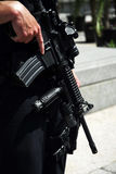Security guard with machine gun. Close up of security guard with firearm Stock Image