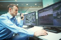 Security worker during monitoring. Video surveillance system. Security guard man monitoring objects. Video surveillance system stock images