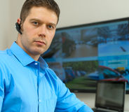 Security guard. Security guard monitoring video in security room royalty free stock images