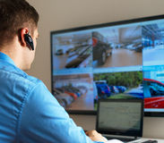 Security guard. Security guard monitoring video in security room Stock Photos