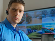 Security guard. Security guard monitoring video in security room Stock Image