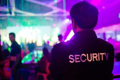 Security guard in night club. Security guard in night club with a lot of people royalty free stock photography