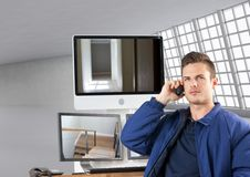 security guard phoning in front of the screens royalty free stock images