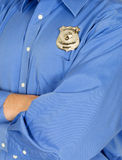 Security Guard, Police, Law Enforcement. Abstract concept for a security guard, public safety, cop, or policeman. The police officer has his arms folded which stock photo