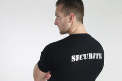 Security guard posing. Over a white background stock images