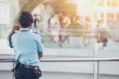 Security guard in public place watching people. For safety tourist travel location stock image
