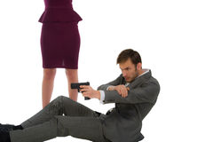 Bodyguard protects the woman. Security guard shoots from the gun protects the women isolated on a white background stock photo