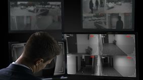 Security guard sleeping in front of surveillance camera, twenty-for-hour work