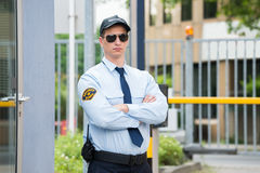 Security Guard Standing Arm Crossed. Confident Young Male Security Guard Standing Arm Crossed Royalty Free Stock Photos