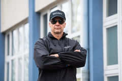 Security Guard Standing Arms Crossed Outside Building. Portrait of confident mature security guard standing arms crossed outside building Stock Photography