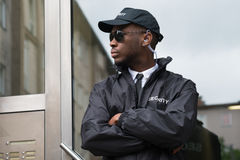 Security Guard Standing Arms Crossed. Portrait Of Young African Male Security Guard Standing Arms Crossed Stock Image