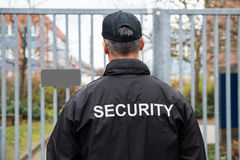 Security Guard Standing In Front Of Gate Stock Image