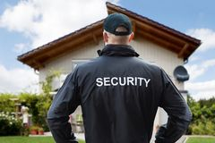 Security Guard Standing Outside The House Stock Images