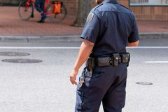 Security guard standing on a street stock images
