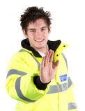 Security guard with a stop sign Royalty Free Stock Photos