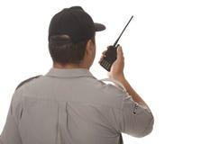 Security guard talking Stock Photo