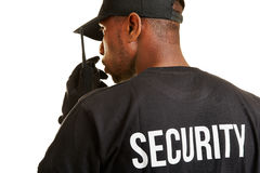 Security guard talking into radio set Royalty Free Stock Photos