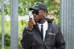 Security Guard Using Walkie-Talkie Royalty Free Stock Images