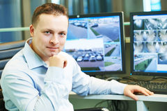 Security guard watching video surveillance system Royalty Free Stock Images