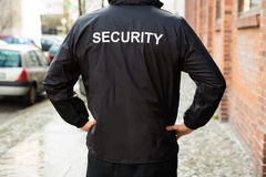 Security Guard Wearing Jacket. Close-up Of Male Security Guard Wearing Black Jacket royalty free stock photography