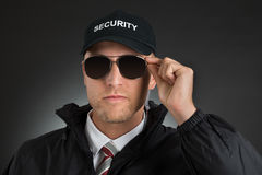 Security Guard Wearing Sun Glasses. Portrait Of Security Guard Wearing Sun Glasses Over Black Background stock images