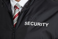 Security Guard Wearing Uniform With The Text Security. Close-up Of Security Guard Wearing Uniform With The Text Security Royalty Free Stock Image