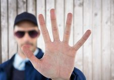 Security guard whit his hand up saying stop. white wood Stock Image