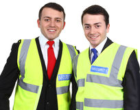 Security guards. Two security guards standing next to each other, isolated on white Stock Photos