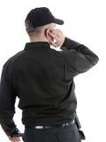 Security guy. Security man wearing black uniform communicating using headset Royalty Free Stock Image
