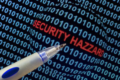 Security Hazard in Red. The words security hazard in red binary code on computer monitor royalty free stock photography
