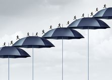 Security Increase. Business safety strategy concept as a group of people running upward with a rising chart of umbrella objects as an employee or career Stock Photo